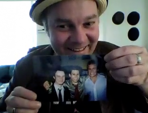 Philip holding up a picture of him with the original Mark.